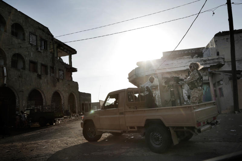 In this Feb. 12, 2018 photo, Saudi-led coalition backed forces patrol Mocha, Yemen. The modern Middle East has been plagued by ruinous wars: country versus country, civil wars with internecine and sectarian bloodletting, and numerous eruptions centered in the Israeli-Palestinian conflict. But never in the last 70 years have they seemed as interconnected as now with Iran and Saudi Arabia vying for regional control, while Israel also seeks to maintain a military supremacy of its own.(AP Photo/Nariman El-Mofty)