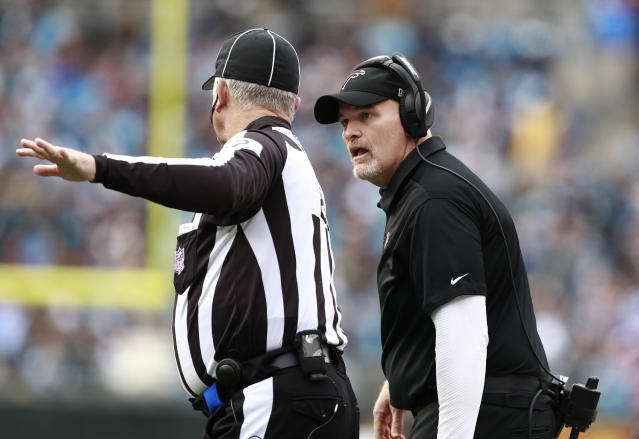 Atlanta Falcons head coach Dan Quinn, right, argues a call during the first half of an NFL football game against the Carolina Panthers in Charlotte, N.C., Sunday, Dec. 23, 2018. (AP Photo/Jason E. Miczek)
