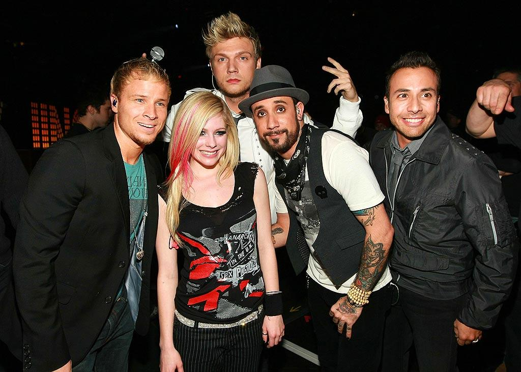 """Pop-punk princess Avril Lavigne and the Backstreet Boys pose for a picture backstage at the 12th annual Z100 Jingle Ball at New York's Madison Square Garden. Dimitrios Kambouris/<a href=""""http://www.wireimage.com"""" target=""""new"""">WireImage.com</a> - December 14, 2007"""