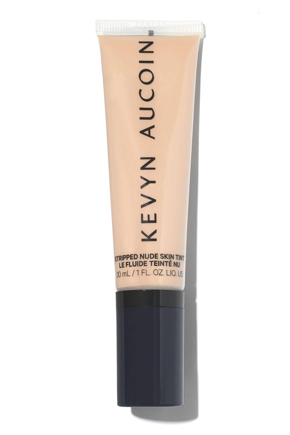 """<p><strong>Kevyn Aucoin</strong></p><p>revolve.com</p><p><strong>$42.00</strong></p><p><a href=""""https://go.redirectingat.com?id=74968X1596630&url=https%3A%2F%2Fwww.revolve.com%2Fdp%2FKEVR-WU298%2F&sref=https%3A%2F%2Fwww.cosmopolitan.com%2Fstyle-beauty%2Fbeauty%2Fg36094404%2Fbest-skin-tints%2F"""" rel=""""nofollow noopener"""" target=""""_blank"""" data-ylk=""""slk:Shop Now"""" class=""""link rapid-noclick-resp"""">Shop Now</a></p><p>This liquid skin tint is <strong>perfect for getting the no-makeup <a href=""""https://www.cosmopolitan.com/style-beauty/beauty/g29548485/best-makeup-products/"""" rel=""""nofollow noopener"""" target=""""_blank"""" data-ylk=""""slk:makeup"""" class=""""link rapid-noclick-resp"""">makeup</a> loo</strong><strong>k</strong> on days when you're feeling low-key, but it's also super buildable which means you can add more layers to create more coverage. No matter how much you apply it still feels lightweight and never gets cakey either.</p>"""