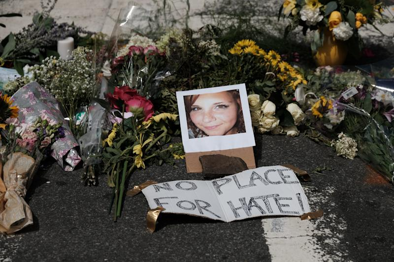 Flowers and a photo of car-ramming victim Heather Heyer lie at a makeshift memorial in Charlottesville, Virginia.  (Justin Ide / Reuters)