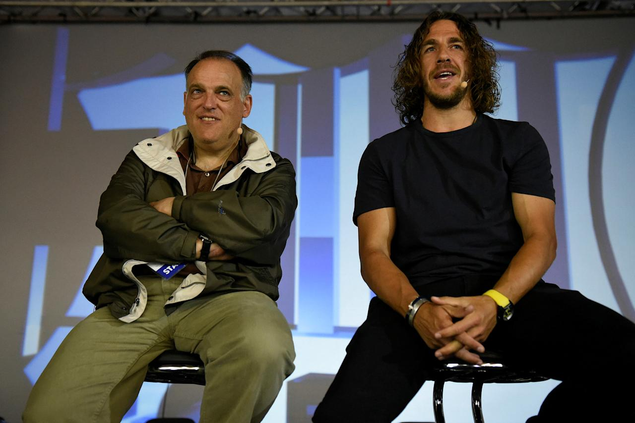 "Ex-Barcelona captain and La Liga ambassador Carles Puyol (R) and La Liga President Xavier Tebas attend an event, before a screening of Spanish first division ""El Clasico"" soccer match between Real Madrid and Barcelona for about a thousand refugees and migrants, in the northern city of Thessaloniki, Greece April 23, 2017. REUTERS/Alexandros Avramidis"