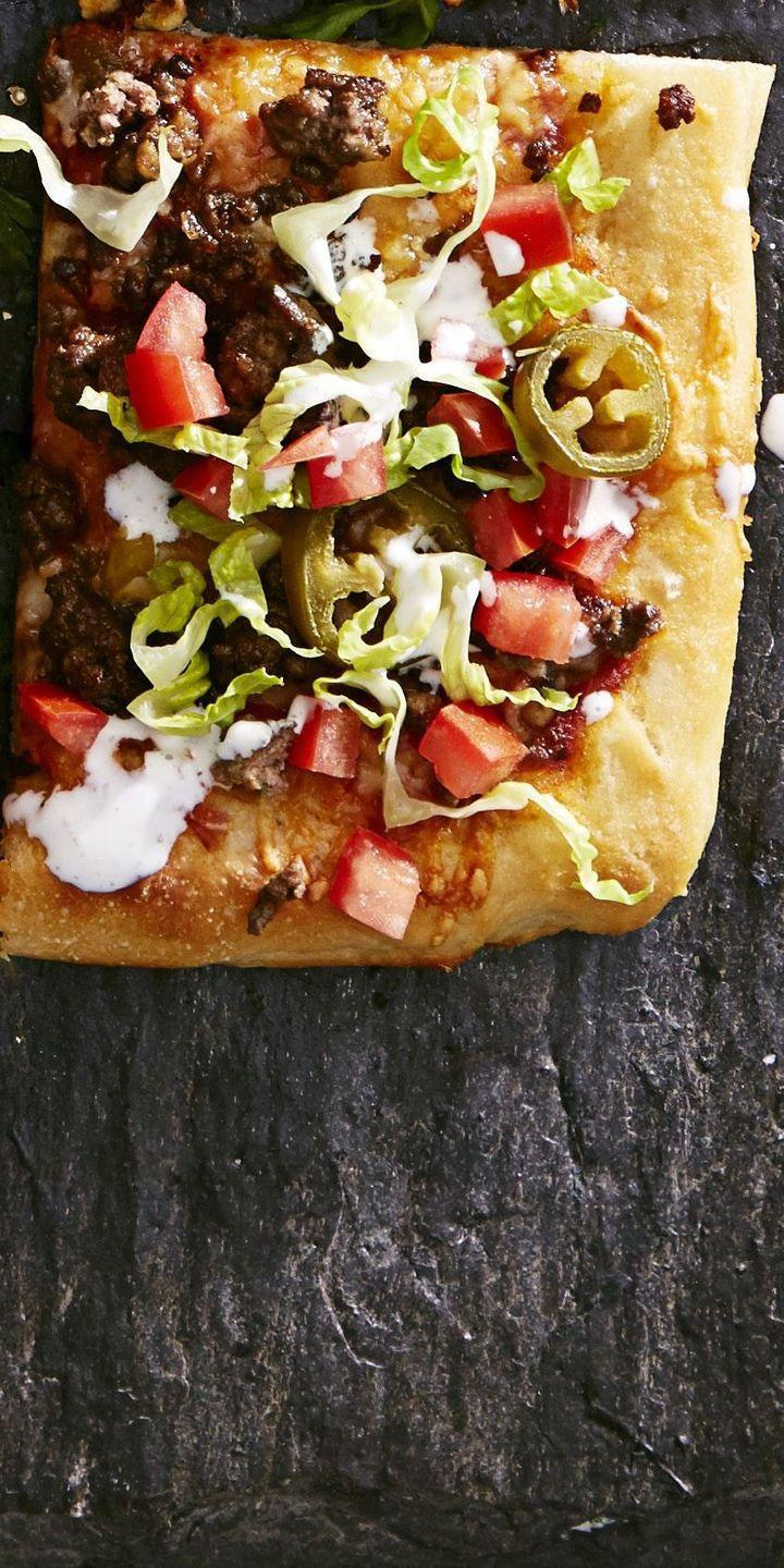"""<p>Tex-Mex isn't just for tacos anymore. Spread those zesty fillings on a pizza crust and get the best of both worlds. </p><p><a href=""""https://www.goodhousekeeping.com/food-recipes/party-ideas/a36232/tex-mex-taco-pizza/"""" rel=""""nofollow noopener"""" target=""""_blank"""" data-ylk=""""slk:Get the recipe for Tex-Mex Taco Pizza »"""" class=""""link rapid-noclick-resp""""><em>Get the recipe for Tex-Mex Taco Pizza »</em></a></p>"""