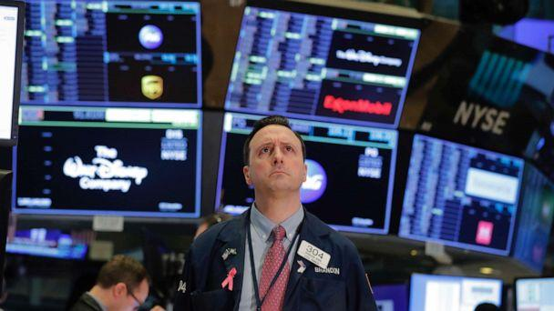 PHOTO: A trader works on the floor of the New York Stock Exchange shortly after the opening of trading in New York, March 13, 2020. (Lucas Jackson/Reuters)