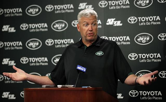 New York Jets head coach Rex Ryan reacts as he speaks with the media after NFL football minicamp, Thursday, June 19, 2014, in Florham Park, N.J. Ryan was asked if the New England Patriots may have obtained a copy of the Jets playbook. (AP Photo/Mel Evans)