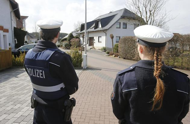 Police hold media away from the house where Andreas Lubitz lived in Montabaur, Germany