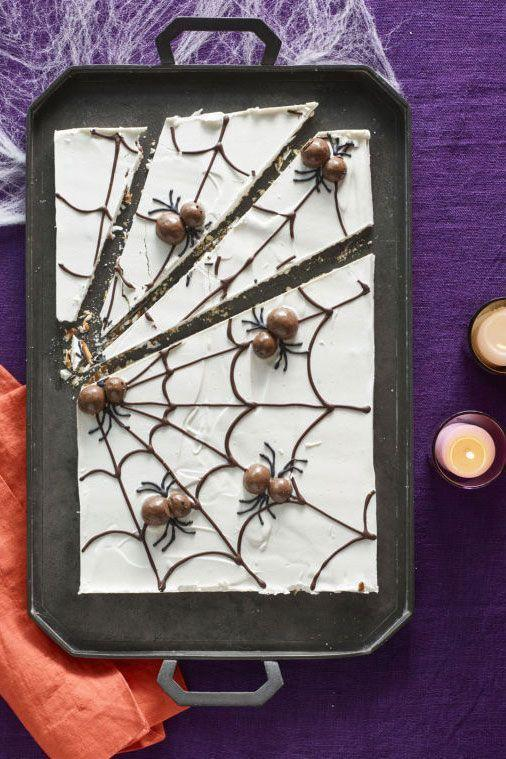 """<p>The best trick this season: Making guests run toward spiders instead of away from them. Cut along the lines of this white chocolate-covered pretzel web for picture-perfect portions.</p><p><strong><em><a href=""""https://www.womansday.com/food-recipes/food-drinks/recipes/a60166/candy-cobwebs-recipe/"""" rel=""""nofollow noopener"""" target=""""_blank"""" data-ylk=""""slk:Get the Candy Cobwebs Bark recipe."""" class=""""link rapid-noclick-resp"""">Get the Candy Cobwebs Bark recipe. </a></em></strong> </p>"""