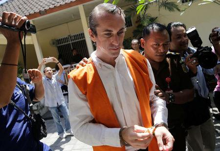 British national David Taylor is escorted into a courtroom for the verdict in his trial over the death of a police officer at the Denpasar District Court in Bali