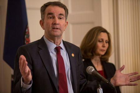 Virginia Governor Ralph Northam, accompanied by his wife Pamela Northam, announces he will not resign during a news conference Richmond, Virginia, U.S. February 2, 2019. REUTERS/ Jay Paul/Files