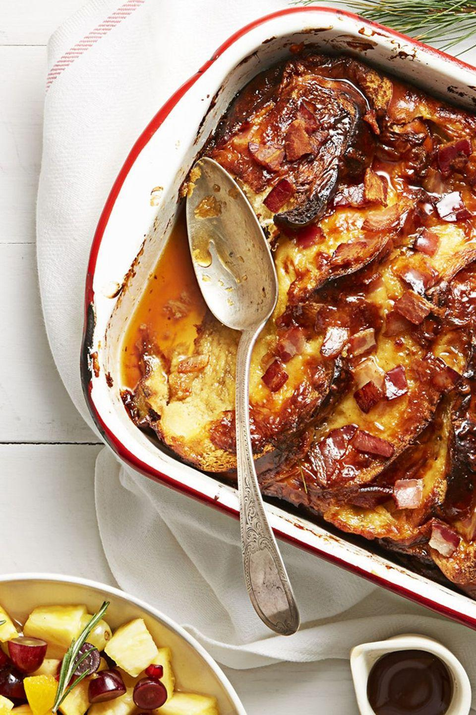 "<p>Sweet slices of French Toast with heavenly pieces of bacon doused in maple syrup? Count us in.</p><p><em><a href=""https://www.goodhousekeeping.com/food-recipes/easy/a35799/bacon-french-toast-bake/"" rel=""nofollow noopener"" target=""_blank"" data-ylk=""slk:Get the recipe for Bacon French Toast Bake »"" class=""link rapid-noclick-resp"">Get the recipe for Bacon French Toast Bake »</a></em></p>"