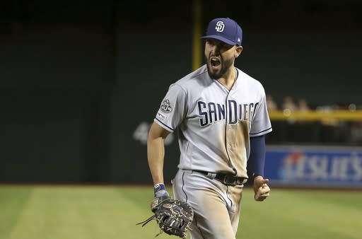 San Diego Padres first baseman Eric Hosmer celebrates after the Padres turned an inning-ending double play against the Arizona Diamondbacks during the seventh inning of a baseball game Saturday, April 13, 2019, in Phoenix. (AP Photo/Ross D. Franklin)