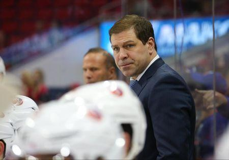 Apr 6, 2017; Raleigh, NC, USA; New York Islanders head coach Doug Weight looks on from behind the players bench against the Carolina Hurricanes at PNC Arena. The New York Islanders defeated the Carolina Hurricanes 3-0. Mandatory Credit: James Guillory-USA TODAY Sports