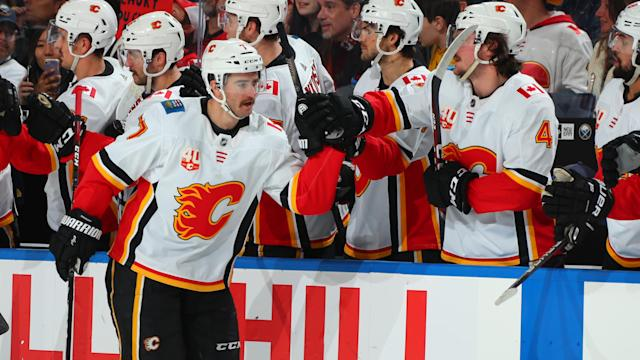 After collapsing during a practice earlier this season, Calgary Flames defenceman TJ Brodie scores his first goal of the season. (Photo by Sara Schmidle/NHLI via Getty Images)