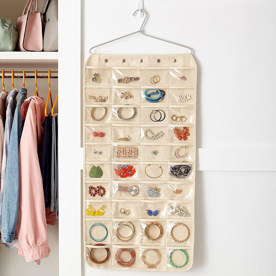 """<p>Keep your jewelry all in one place with this <a href=""""https://www.popsugar.com/buy/80-Pocket-Canvas-Hanging-Organizer-483843?p_name=80-Pocket%20Canvas%20Hanging%20Organizer&retailer=containerstore.com&pid=483843&price=25&evar1=casa%3Aus&evar9=46534838&evar98=https%3A%2F%2Fwww.popsugar.com%2Fhome%2Fphoto-gallery%2F46534838%2Fimage%2F46535439%2F80-Pocket-Canvas-Hanging-Jewelry-Organizer&list1=shopping%2Corganizing%2Cfurniture%2Cbedrooms%2Chome%20organization%2Chome%20shopping&prop13=mobile&pdata=1"""" rel=""""nofollow"""" data-shoppable-link=""""1"""" target=""""_blank"""" class=""""ga-track"""" data-ga-category=""""Related"""" data-ga-label=""""https://www.containerstore.com/s/jewelry-storage/view-all-jewelry-storage/80-pocket-canvas-hanging-jewelry-organizer/12d?productId=10014111"""" data-ga-action=""""In-Line Links"""">80-Pocket Canvas Hanging Organizer</a> ($25).</p>"""