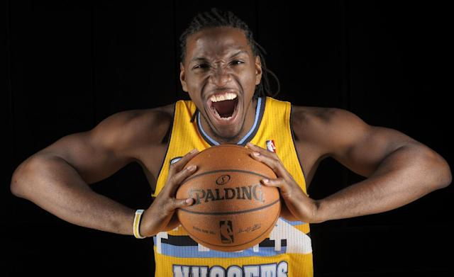 Kenneth Faried poses for a photo during Denver Nuggets NBA basketball media day on Monday, Sept. 30, 2013, in Denver. (AP Photo/Jack Dempsey