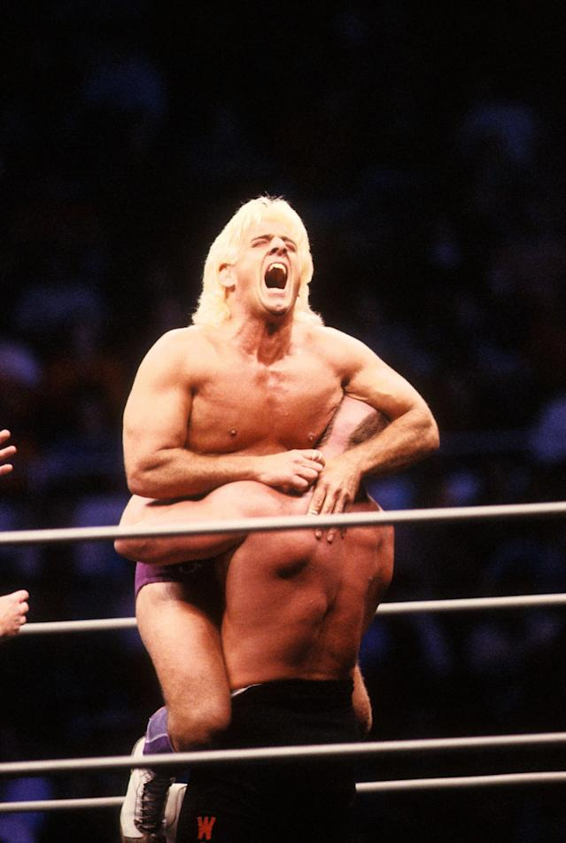 """<p>Road Warrior Hawk squeezes the """"Nature Boy"""" Rick Flair during their Heavy Weight bout at the 1988 Bunkhouse Stampede on January 24, 1988 at the Nassau Coliseum in Uniondale, New York. (Photo by B Bennett/Getty Images) </p>"""