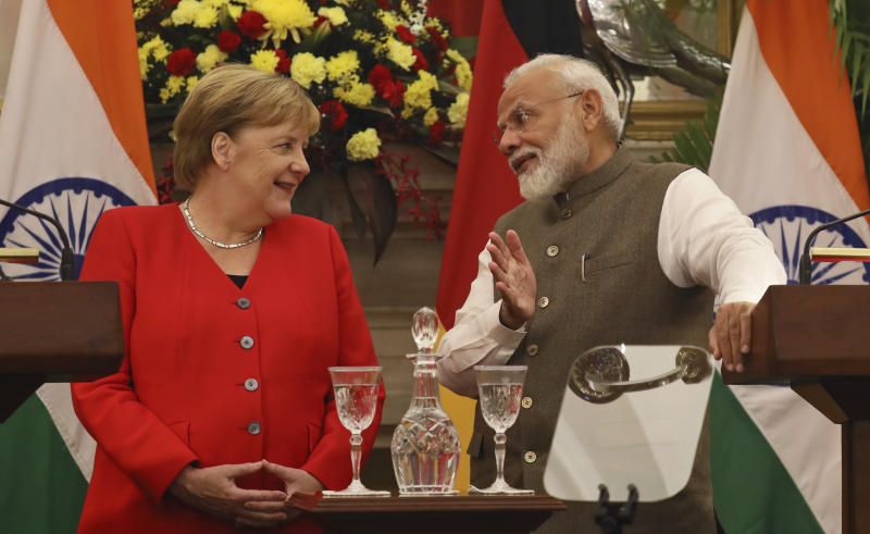Indian Prime Minister Narendra Modi, right, talks with German Chancellor Angela Merkel during a signing of agreements ceremony between the two countries, in New Delhi, India, Friday, Nov. 1, 2019. India and Germany have agreed to enhance cooperation in tackling climate change, cybersecurity, skill development, artificial intelligence, energy security, civil aviation and defense production. The two countries signed several agreements on Friday, with Prime Minister Narendra Modi saying India is eager to benefit from Germany's expertise. (AP Photo/Manish Swarup)