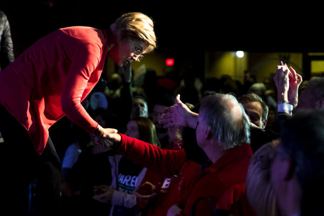 Warren greets attendees during a campaign event in Derry, N.H., on Thursday. (Matt Rourke/AP)