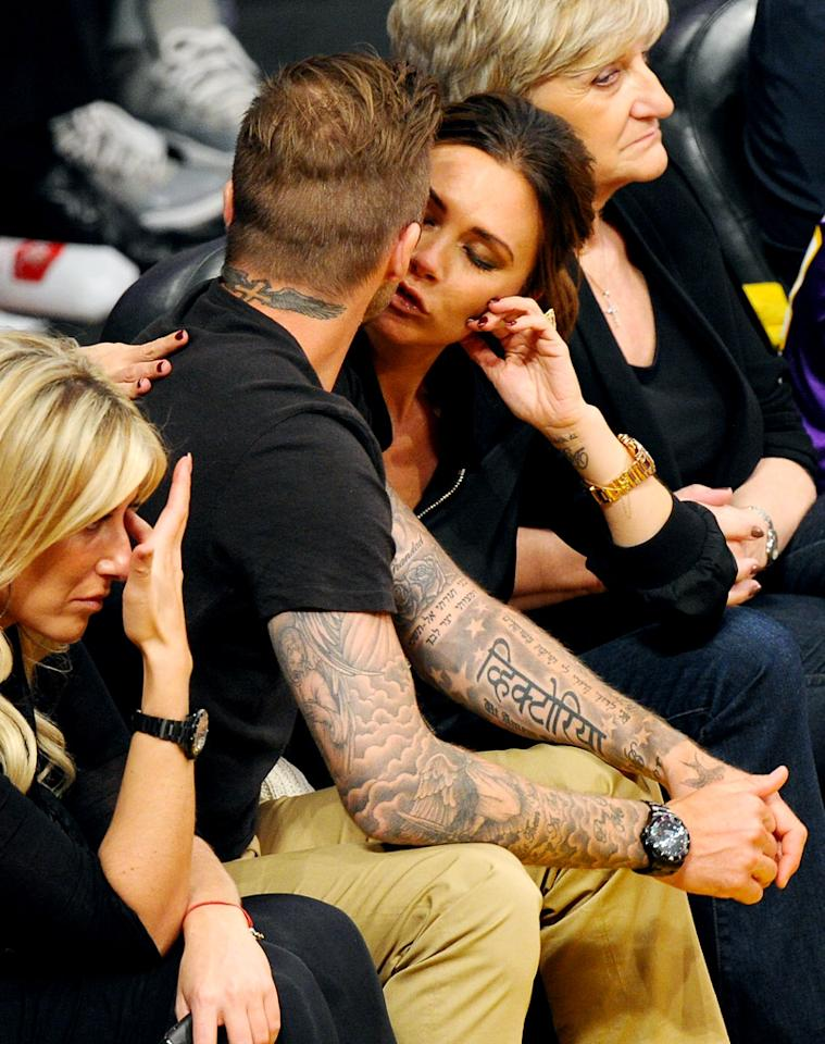 "<p class=""MsoNormal"">After four kids and 13 years of marriage, Victoria and David Beckham still have the hots for each other! The ridiculously attractive couple was caught locking lips at L.A.'s Staples Center on the eve of David's 37<sup>th</sup> birthday, as the Lakers took on the Denver Nuggets in the NBA playoffs. (5/1/2012)</p>"
