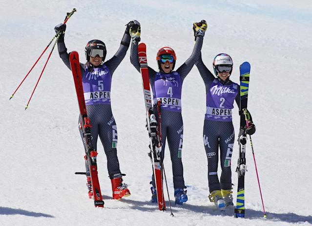 First place finisher Italy's Federica Brignone, center, celebrates with second place finisher Italy's Sofia Goggia, left, and third place finisher Italy's Marta Bassino after the second run of a women's World Cup giant slalom ski race Sunday, March 19, 2017, in Aspen, Colo. (AP Photo/Nathan Bilow)
