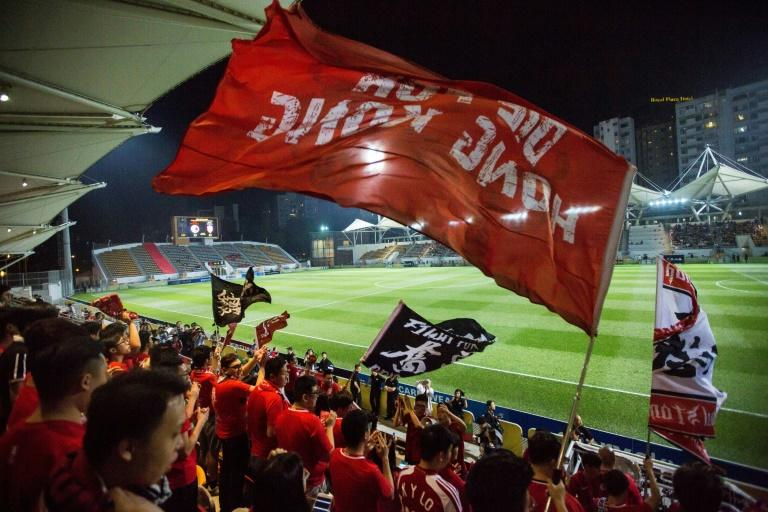 "Hong Kong fans fly a flag that says ""Die for Hong Kong"" before an international friendly football match between Hong Kong and Bahrain at Mong Kok Stadium in Hong Kong on November 9, 2017"