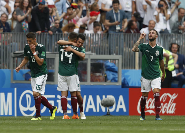 Mexico players celebrate a goal by Mexico's Hirving Lozano, center right, during the group F match between Germany and Mexico at the 2018 soccer World Cup in the Luzhniki Stadium in Moscow, Russia, Sunday, June 17, 2018. (AP Photo/Eduardo Verdugo)