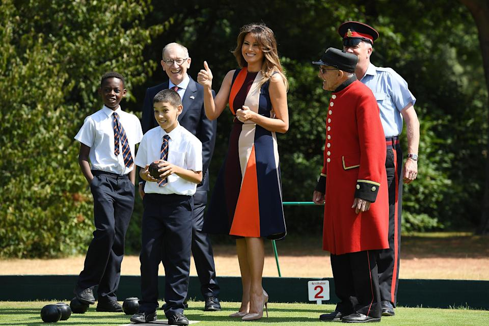 This morning's engagement in London, without the President, shows a softer side to Melania [Photo: Getty]