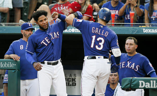 Texas Rangers' Joey Gallo (13) is congratulated by Elvis Andrus, left, after hitting a solo home run during the fourth inning of a baseball game against the Houston Astros, Friday, July 12, 2019, in Arlington, Texas. (AP Photo/Brandon Wade)