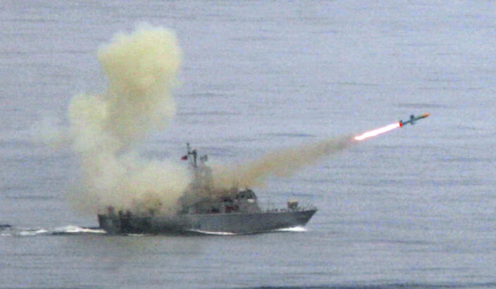 """FILE - In this May 16, 2007, file photo, a Taiwanese navy frigate launches a """"Harpoon"""" surface-to-surface missile during the second day of the annual Hankuang military exercises off Ilan, central eastern coast of Taiwan. The State Department says it has notified Congress of plans for a $2.37 billion sale of Harpoon attack missiles to Taiwan, a move likely to anger China. The announcement on Oct. 26, 2020, came just hours after China said it will sanction Boeing Co.'s defense unit, Lockheed Martin Corp. and other U.S. military contractors for supplying weapons to Taiwan.(AP Photo/Wally Santana, File)"""