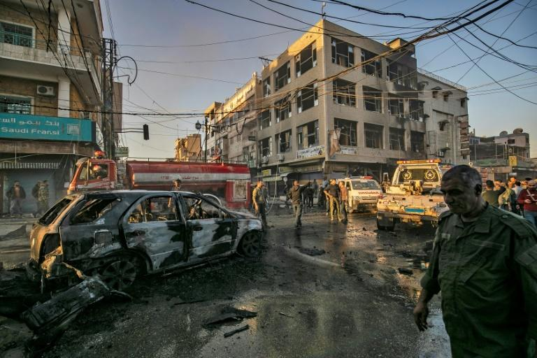 Simultanaous blasts near a busy market and a school in Syria's Kurdish-majority city of Qamishli killed six people and wounded 22