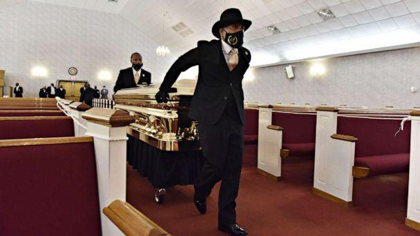 PHOTO: The casket carrying the body of George Floyd is brought inside for his memorial services at R.L Douglas Cape Fear Conference B - The United American Free Will Baptist Denomination in Raeford, North Carolina, June 2020. (Ed Clemente/POOL/EPA via Shutterstock)