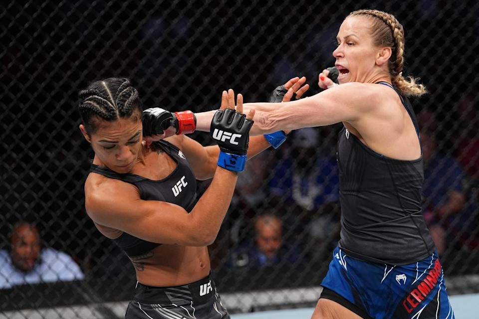 Katlyn Chookagian punches Viviane Araujo of Brazil in their women's flyweight bout during the UFC 262 event.