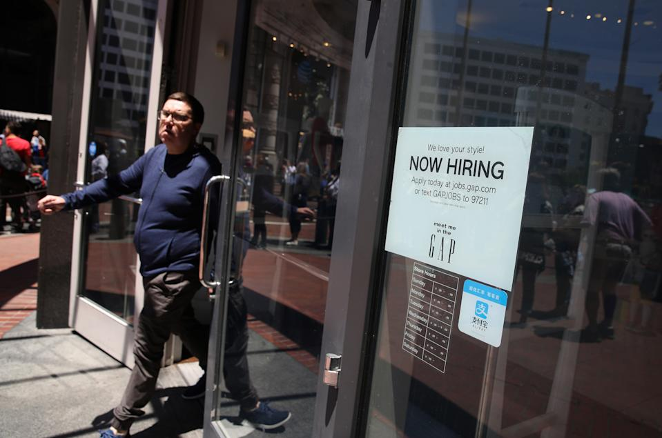 SAN FRANCISCO, CALIFORNIA - JUNE 07: A now hiring sign is posted in the window of a Gap store on June 07, 2019 in San Francisco, California. According to a report by the U.S. Labor Department, The U.S. economy added 75,000 jobs in May compared to the 224,000 jobs that were added in April. The unemployment rate remained at 3.6 percent, a five decade low.(Photo by Justin Sullivan/Getty Images)