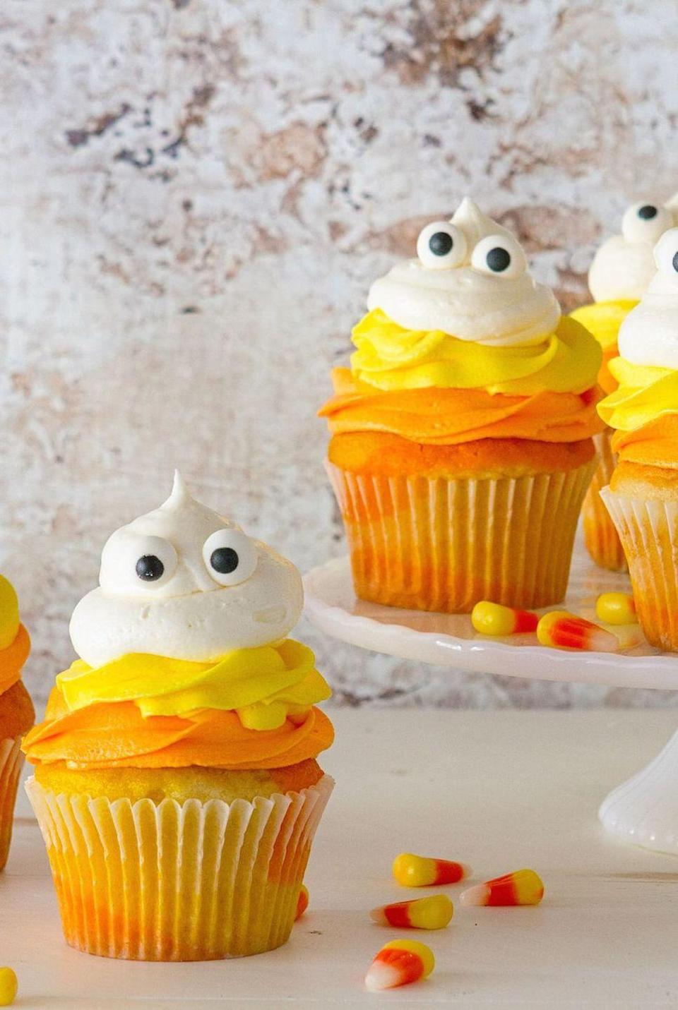 """<p>Combine two of Halloween's finest — candy corn and ghosts — in these colorful vanilla cupcakes. </p><p><em><a href=""""https://www.delish.com/holiday-recipes/halloween/videos/a44373/candy-corn-cupcakes/"""" rel=""""nofollow noopener"""" target=""""_blank"""" data-ylk=""""slk:Get the recipe from Delish »"""" class=""""link rapid-noclick-resp"""">Get the recipe from Delish »</a></em><br></p>"""