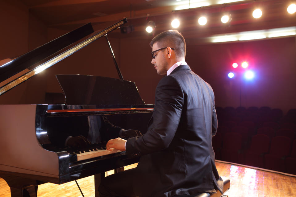 Piano player playing in a concert hall