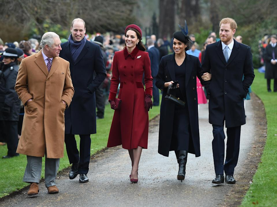 <p>The Duchesses wrapped up for Christmas 2018. Kate wore a burgundy double-breasted coat by Catherine Walker, with a Jane Taylor halo band, her Granvito Rossi 105 pumps in the bordeaux colourway and her Mulberry Bayswater clutch bag. She accessorised with her Asprey oak leaf earrings and a new floral brooch. Pregnant Meghan wore a navy overcoat and knee-high boots by Victoria Beckham, with a navy midi dress and matching hat. [Photo: PA] </p>
