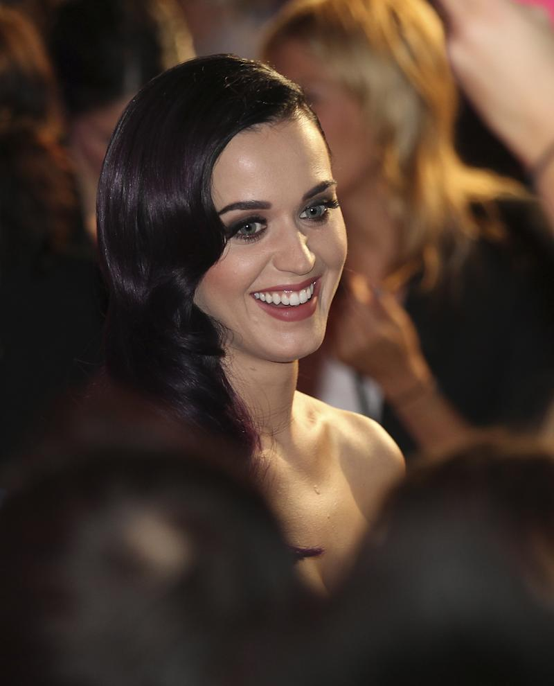 "Singer Katy Perry arrives for the Australian premiere of her movie ""Part of Me""  in Sydney, Australia,  Saturday, June 30, 2012. (AP Photo/Rob Griffith)"