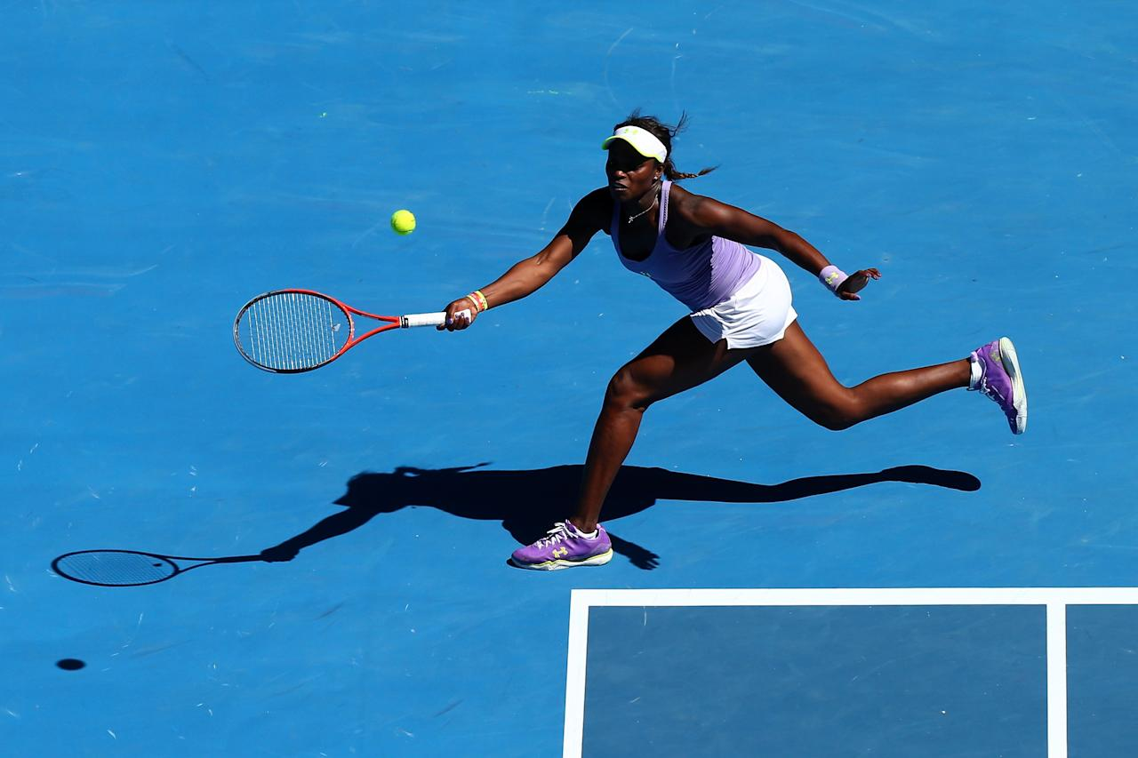 MELBOURNE, AUSTRALIA - JANUARY 23:  Sloane Stephens of the United States plays a forehand Quarterfinal match against Serena Williams of the United States during day ten of the 2013 Australian Open at Melbourne Park on January 23, 2013 in Melbourne, Australia.  (Photo by Ryan Pierse/Getty Images)