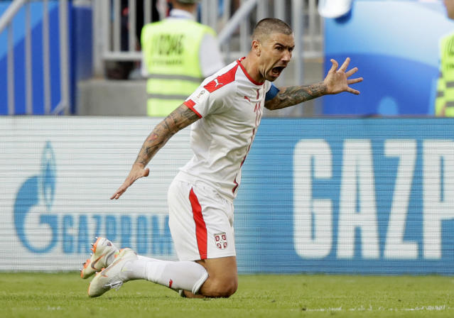 Serbia's Aleksandar Kolarov celebrates with after scoring the opening goal during the group E match between Costa Rica and Serbia at the 2018 soccer World Cup in the Samara Arena in Samara, Russia, Sunday, June 17, 2018. (AP Photo/Mark Baker)