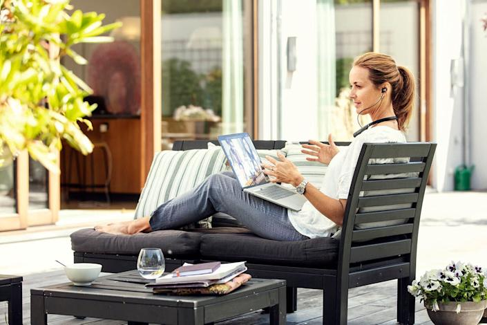 Woman chatting on a work call (Photo: EPOS)