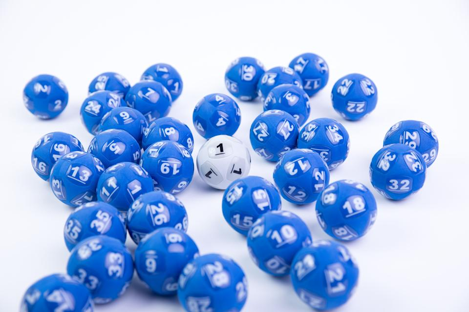 Pictured is blue and white lottery balls, tonight's Powerball Jackpot has reached $20 million.
