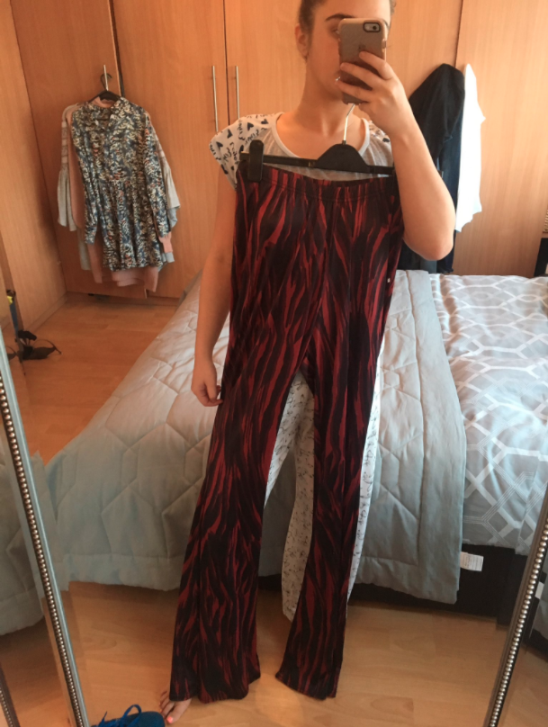 Bethany McNamara ordered some 'high-waisted' pants online for a night out, but when she opened the black and red flare pants, they were almost the length of her entire five-foot-two body.