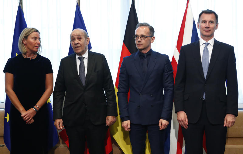 From left, European Union foreign policy chief Federica Mogherini, French Foreign Minister Jean-Yves Le Drian, German Foreign Minister Heiko Maas and British Foreign Secretary Jeremy Hunt pose for a photo prior to a meeting at the European Council in Brussels, Monday, May 13, 2019. (Francois Lenoir, Pool Photo via AP)