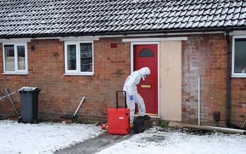 A police forensics officer outside the property in Brownhills, near Walsall - Credit: Matthew Cooper/PA