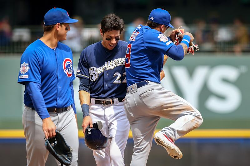 MILWAUKEE, WISCONSIN - JULY 28: Christian Yelich #22 of the Milwaukee Brewers and Javier Baez #9 of the Chicago Cubs meet in the fifth inning at Miller Park on July 28, 2019 in Milwaukee, Wisconsin. (Photo by Dylan Buell/Getty Images)