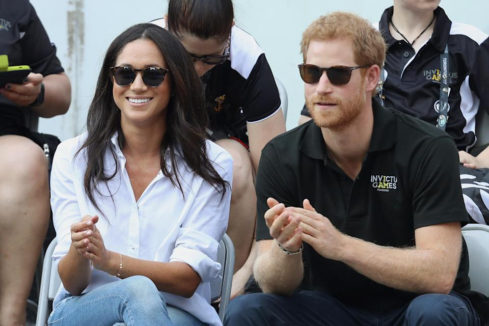 Meghan and Harry are keen sport fans. Copyright: [Rex]