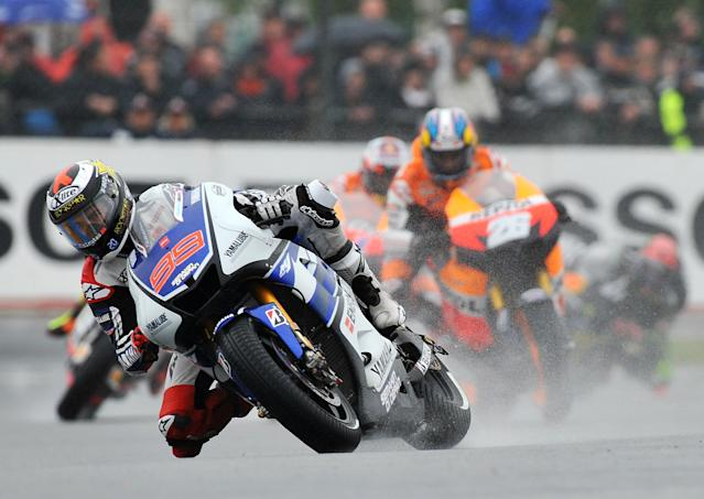 Spanish Jorge Lorenzo (Front), competes on his Yamaha ahead of Dani Pedrosa (Honda) during the French Moto GP Grand Prix at Le Mans's circuit, western France on May 20,2012. Lorenzo finished 1st. Pedroza 4th. AFP PHOTO / ALAIN JOCARDALAIN JOCARD/AFP/GettyImages