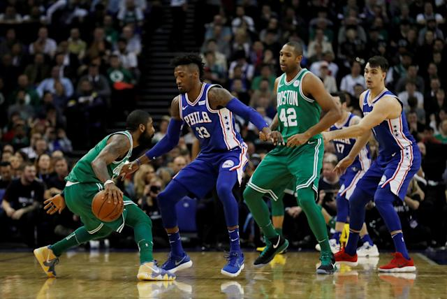 Basketball - NBA - Boston Celtics vs Philadelphia 76ers - O2 Arena, London, Britain - January 11, 2018 Boston Celtics' Kyrie Irving in action with Philadelphia 76ers' Robert Covington REUTERS/Matthew Childs TPX IMAGES OF THE DAY