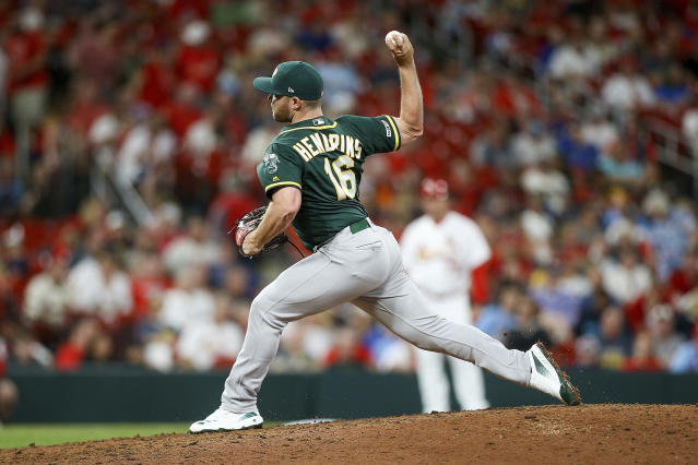 Oakland Athletics relief pitcher Liam Hendriks delivers during the ninth inning of the team's baseball game against the St. Louis Cardinals on Wednesday, June 26, 2019, in St. Louis. (AP Photo/Scott Kane)