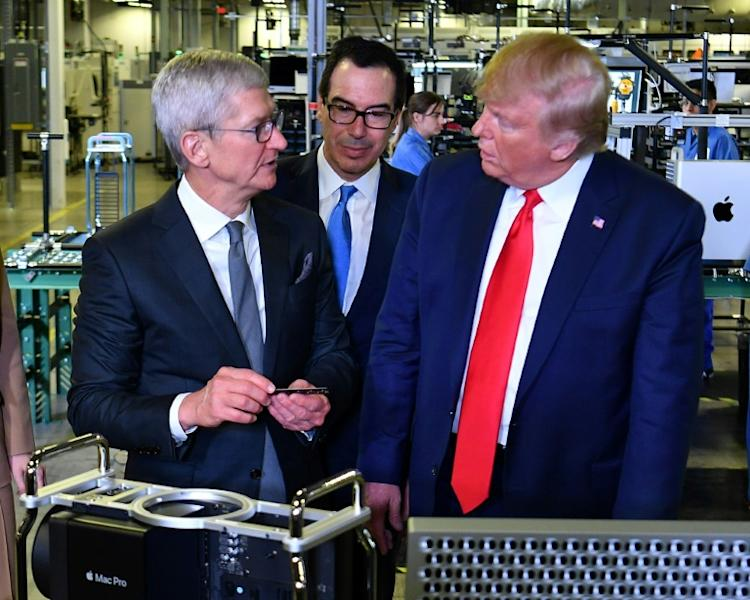 L-R: Apple CEO Tim Cook, Treasury Secretary Steven Mnuchin and President Donald Trump tour the facility where Mac Pros are assembled in Austin, Texas, on November 20 (AFP Photo/MANDEL NGAN)